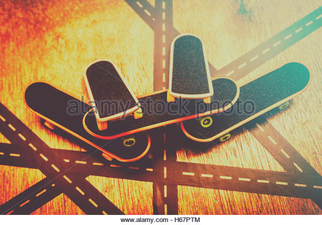 Urban streets games in a still of retro skateboard decks placed on skatepark intersections. Eighties street skateboarders - Stock Image