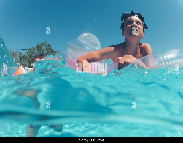 Low Angle View Of Boy Swimming In Pool - Stock Image