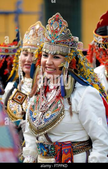 Women in costume celebrating feast of Virgen del Carmen de Paucartambo (Cusco Province), near Plaza de Armas, Lima, - Stock Image