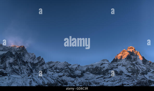 Last rays of sun on the top of the Mount Cervino in winter season, Aosta Valley - Italy - Stock Image