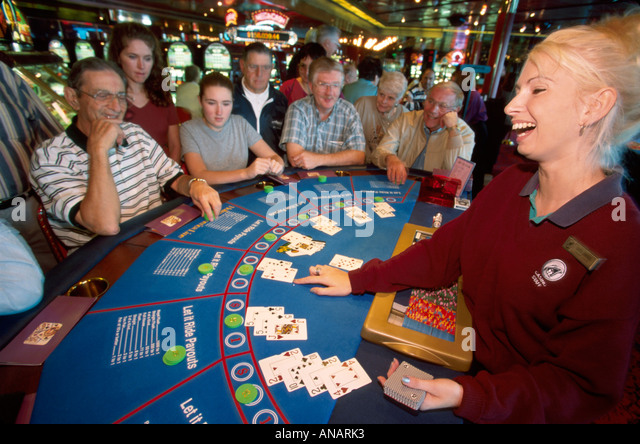Italy Holland America Line ms Rotterdam cruise ship passengers Black Jack dealer lessons casino gambling woman man - Stock Image