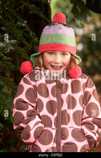 Portrait of girl (4-5) with mouth open, wearing hat with earflaps - Stock Image