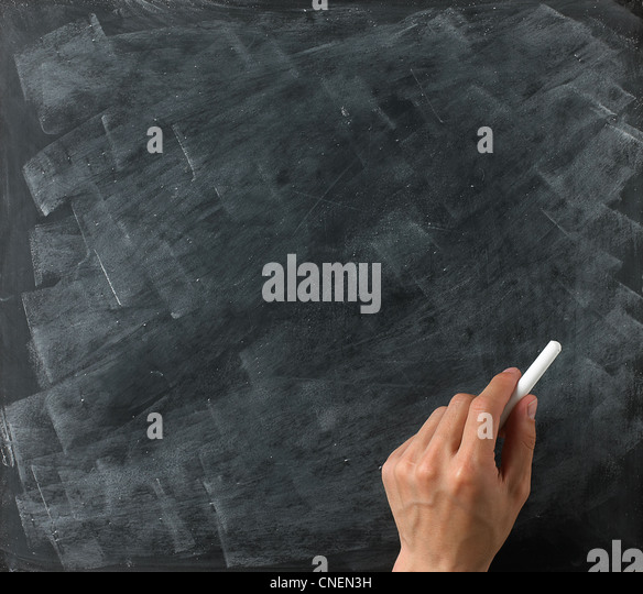 a blank blackboard and chalk ready for your copy or text with hand - Stock Image