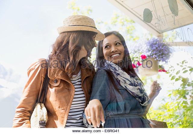 Women window shopping on village street - Stock-Bilder
