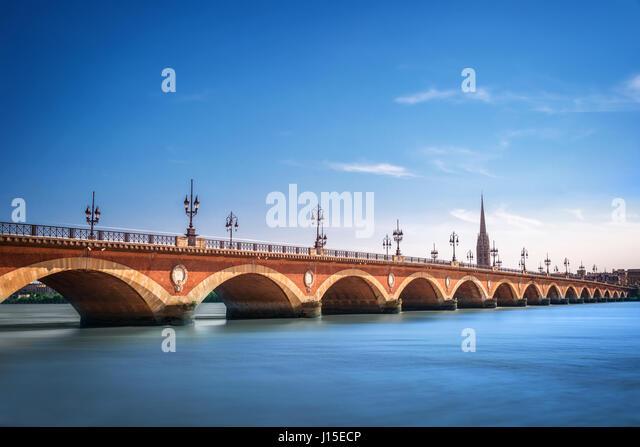 Pont de Pierre bridge with St Michel cathedral, Bordeaux, France - Stock Image