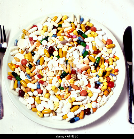 medicine pills on plate. Photo by Willy Matheisl - Stock Image