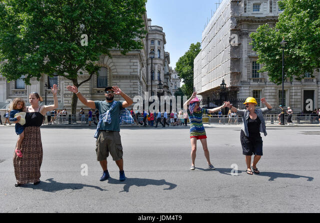 London, UK. 21st June, 2017. Anti-Tory protesters stage a 'dance off' outside Downing Street following the - Stock Image