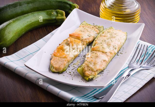 Zucchini stuffed with cheese. - Stock Image