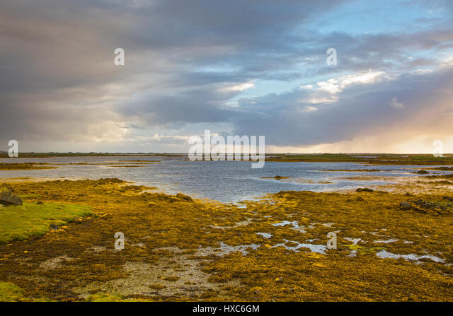Tranquil scene clouds over lake, Loch Euphoirt, North Uist, Outer Hebrides - Stock Image