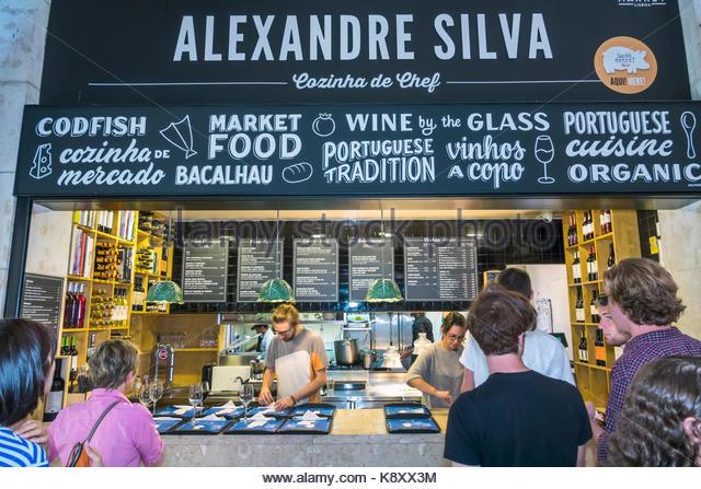 Portugal Lisbon Cais do Sodre Mercado Da Ribeira market hall food court dining Chef Alexandre Silva traditional - Stock Image