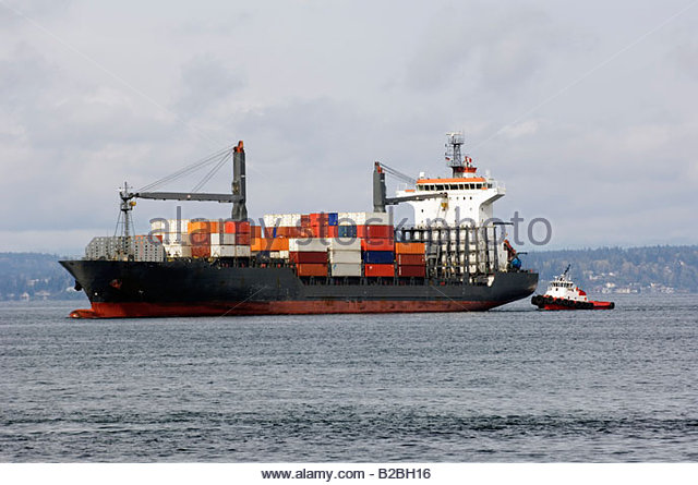 Container ship and tug boat - Stock Image