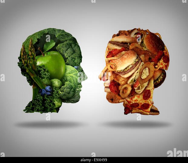 Lifestyle choice and dilemma concept as a two human faces one made of fresh green vegetables and fruit and the other - Stock Image