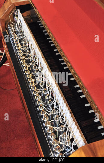 UAV Harpsichord. Goble two-manual harpsichord made in 1970, being played by a new MIDI-driven U.A.V. (Unmanned Awesome - Stock Image