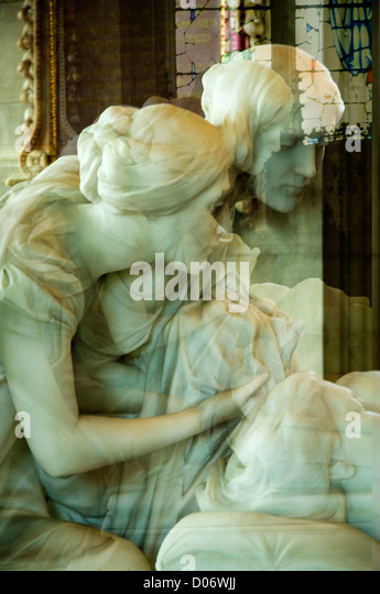 Marble Sculptures demonstrating love and pity in a Derbyshire Church - Stock Image