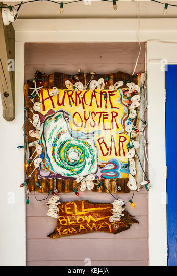 Outdoor sign for the Hurricane Oyster Bar in a small shopping center, Grayton Beach Florida, USA. - Stock Image