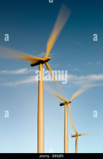 Wind turbines generate electricity as they spin in Texas windfarm. - Stock Image