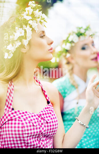 Two gorgeus women in the fresh green garden - Stock Image