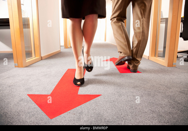 People walking in different directions - Stock Image