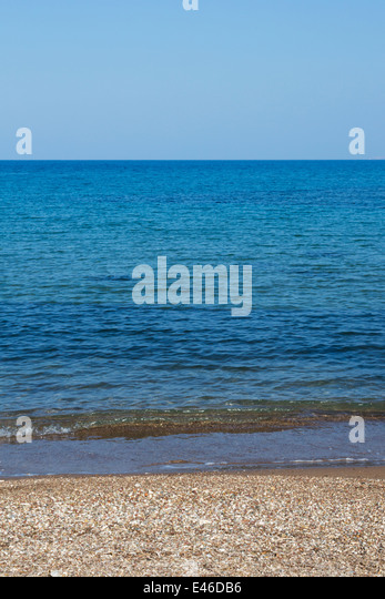 Blue sea and small pebbled beach. Cyprus - Stock Image
