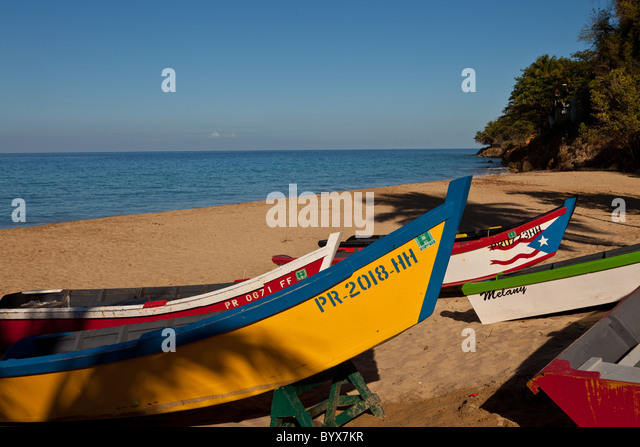 Colorful yolas along Crash Boat beach Aguadilla Puerto Rico - Stock Image