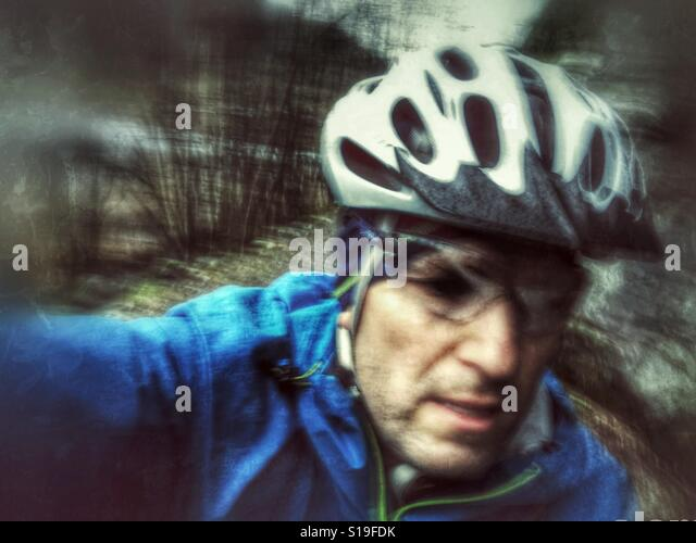Action cam selfie during a bike ride - Stock Image