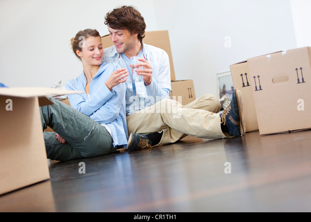 Couple toasting each other with water - Stock Image