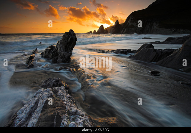 Surging tide on the shores of Westcombe Bay, Devon - Stock Image