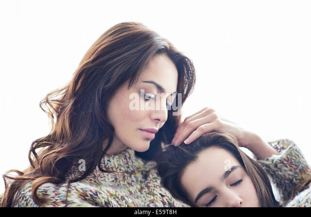 Mother hugging child - Stock Image