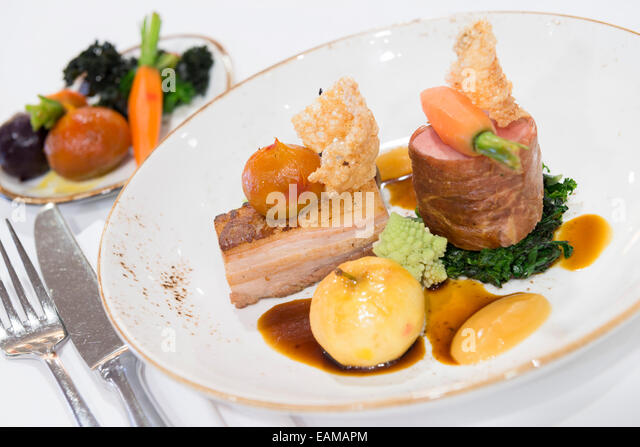 Pork two ways served in a fine dining restaurant. - Stock Image
