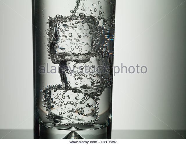 Ice cubes in highball glass - Stock Image