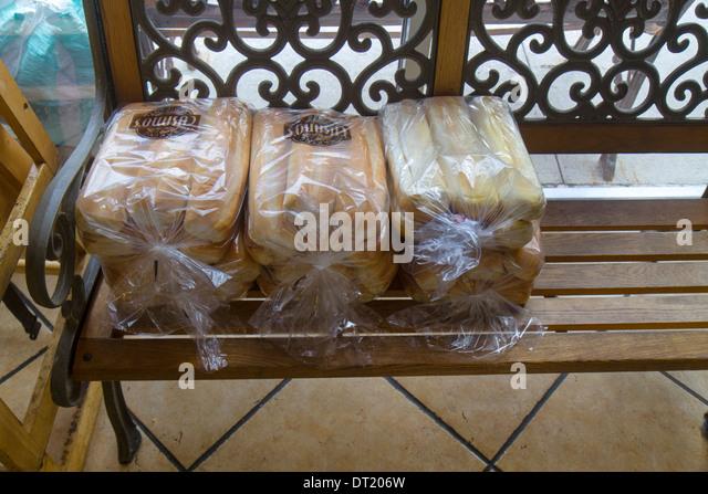Naples Florida restaurant storage storing bread buns rolls bench - Stock Image
