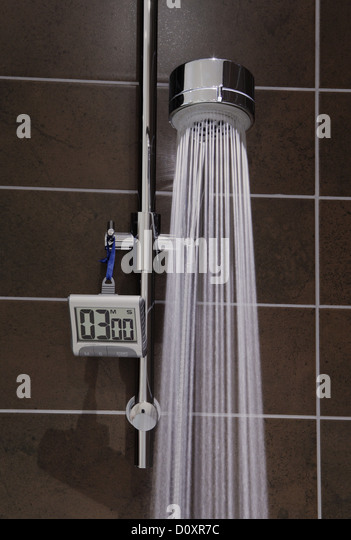 Shower with timer and running water - Stock Image