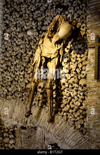 Wall decorated with the mummified body of a human being believed to be a man, Evora, Alentejo, Portugal, Europe - Stock Image