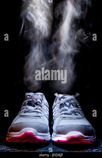 Trainers smoking after a long run - Stock Image