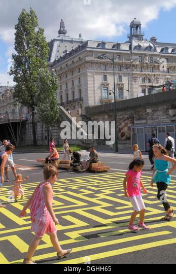 Paris France Europe French Seine River La Rive Gauche Left Bank Berges de Seine giant maze Asian girl - Stock Image