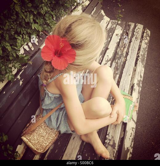 Summer park bench - Stock Image