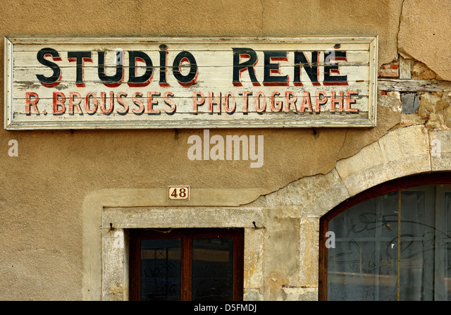Old shop sign St Antonin Noble Val, Tarn et Garonne, France - Stock Image