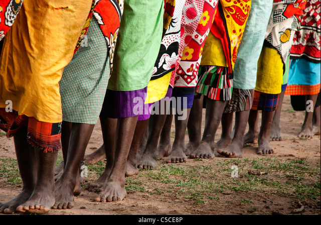 masai-women-doing-a-welcome-dance-at-a-v