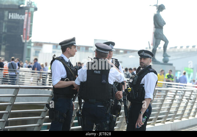 Armed police patrol crowds at the FA cup final between Arsenal and Chelsea at Wembley Stadium, London  Featuring: - Stock-Bilder