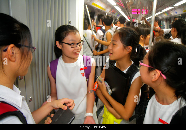 Singapore Bishan MRT Station Circle Line subway train public transportation riders commuters Asian girl student - Stock Image