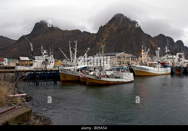 Fishing boats on a quay in Svolvær, Lofoten, Norway - Stock Image