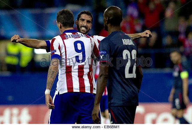 Madrid. 26th Nov, 2014. SPAIN, Madrid: Atletico de Madrid's Croatian forward Mario Mandzukic and Raul Garcia - Stock Image