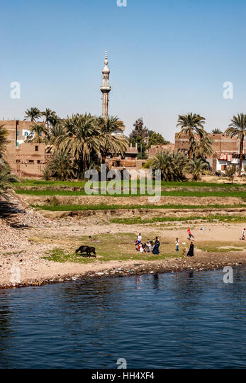 Cruises along the Nile River in Egypt show people living their daily lives much as it had been for centuries. - Stock-Bilder