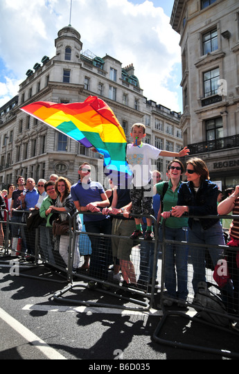 Young Teen Waving Gay Rainbow Flag at the Gay Pride Parade