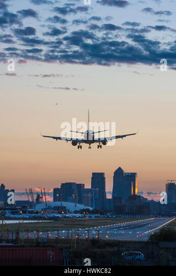 Airplane landing at London City Airport, UK - Stock Image