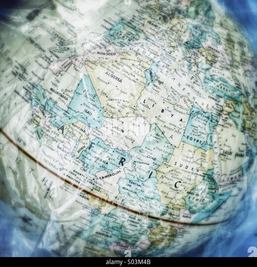 Globe showing Africa covered in clear plastic. - Stock Image