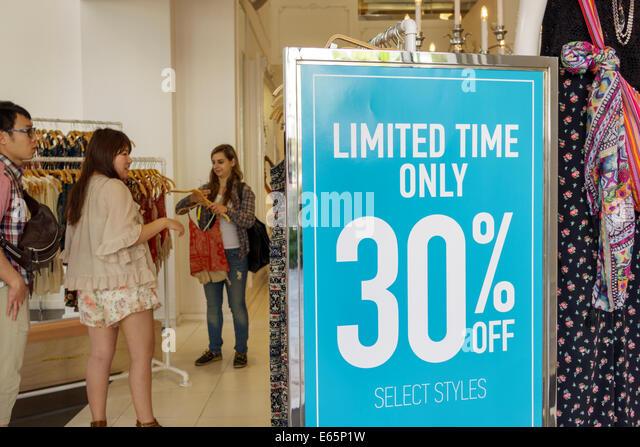Hawaii Hawaiian Honolulu Waikiki Beach resort Kalakaua Avenue shopping clothing store women's fashion sign 30% - Stock Image