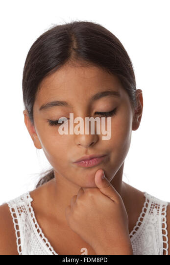 Young uncertain teenage girl, portrait on white background - Stock Image