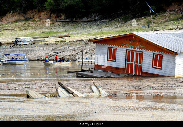 Houseboat beached David Marina due to drought in the Rio Negro - Stock Image