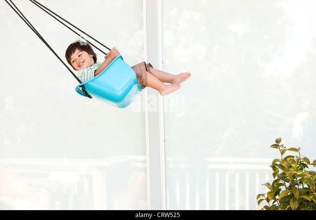 boy swinging - Stock-Bilder